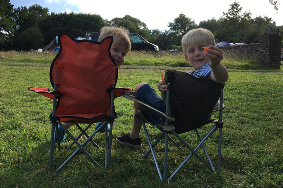 Boys sitting in camp chairs