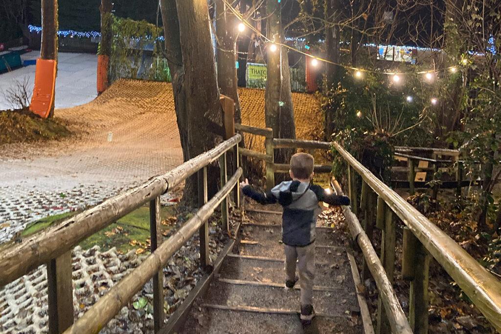 Boy descending steps