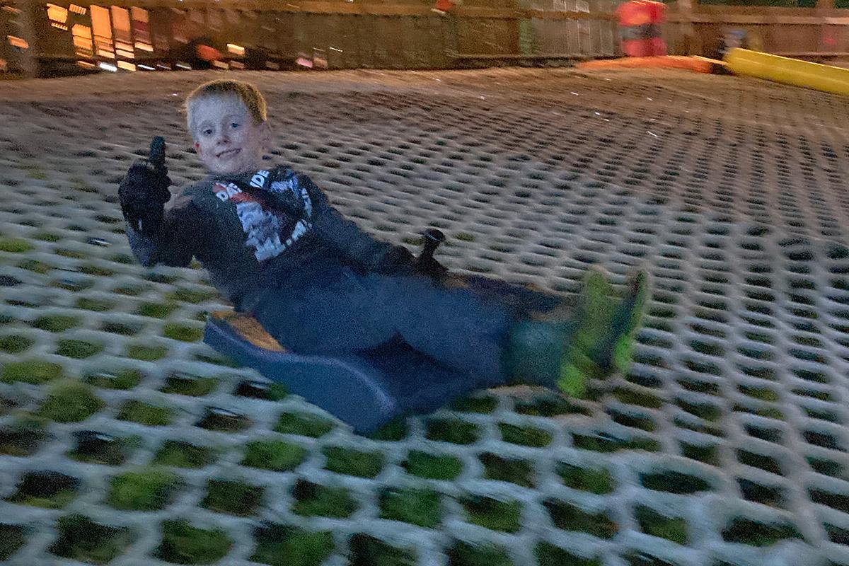 Boy tobogganing