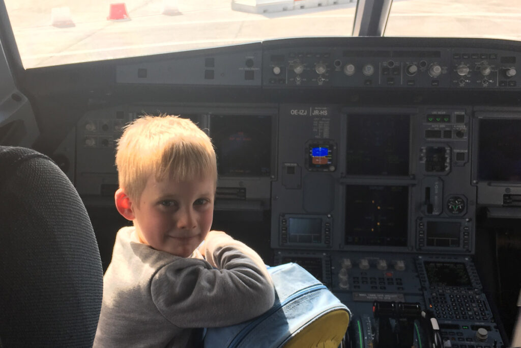 Boy sitting in a aeroplane cockpit