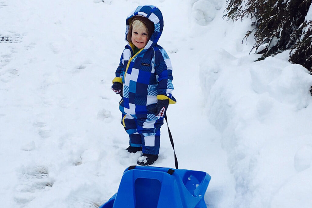 Toddler with a sledge