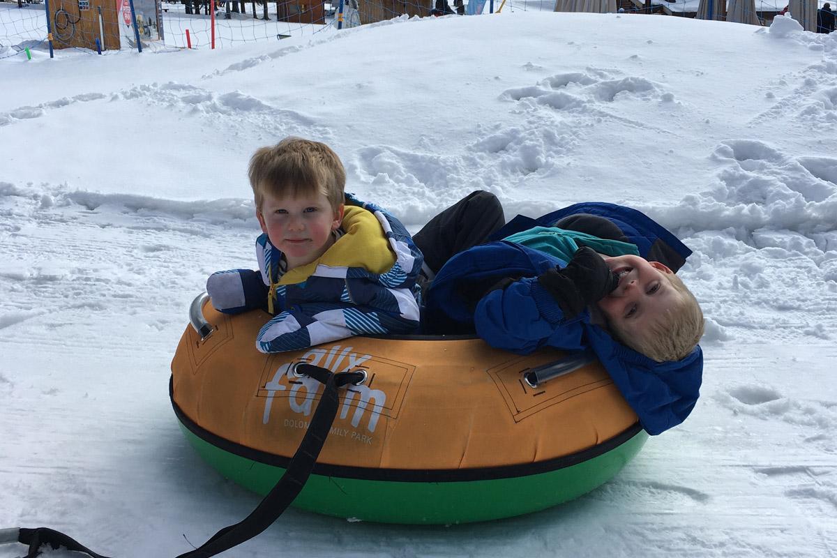 Young boys snowtubing